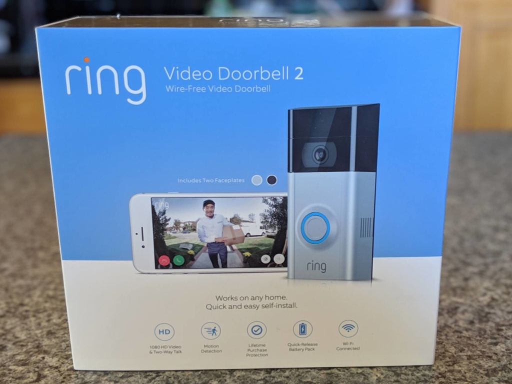 video doorbell in box on counter in home
