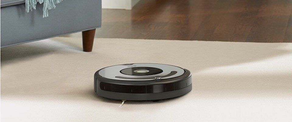 robot vacuum cleaning carpeted floor