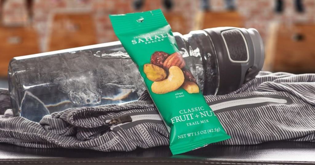 sahale fruit and nut bar resting on water bottle