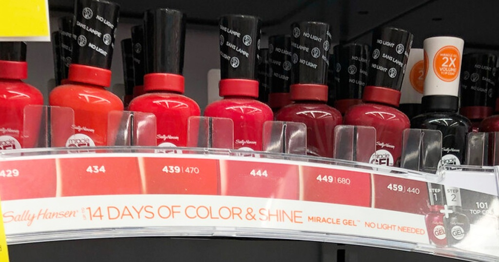 store display of sally hansen miracle gel nail polish in red shades