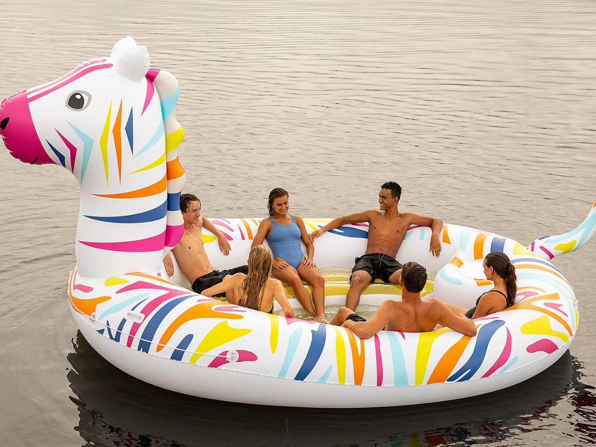 people sitting in giant zebra float