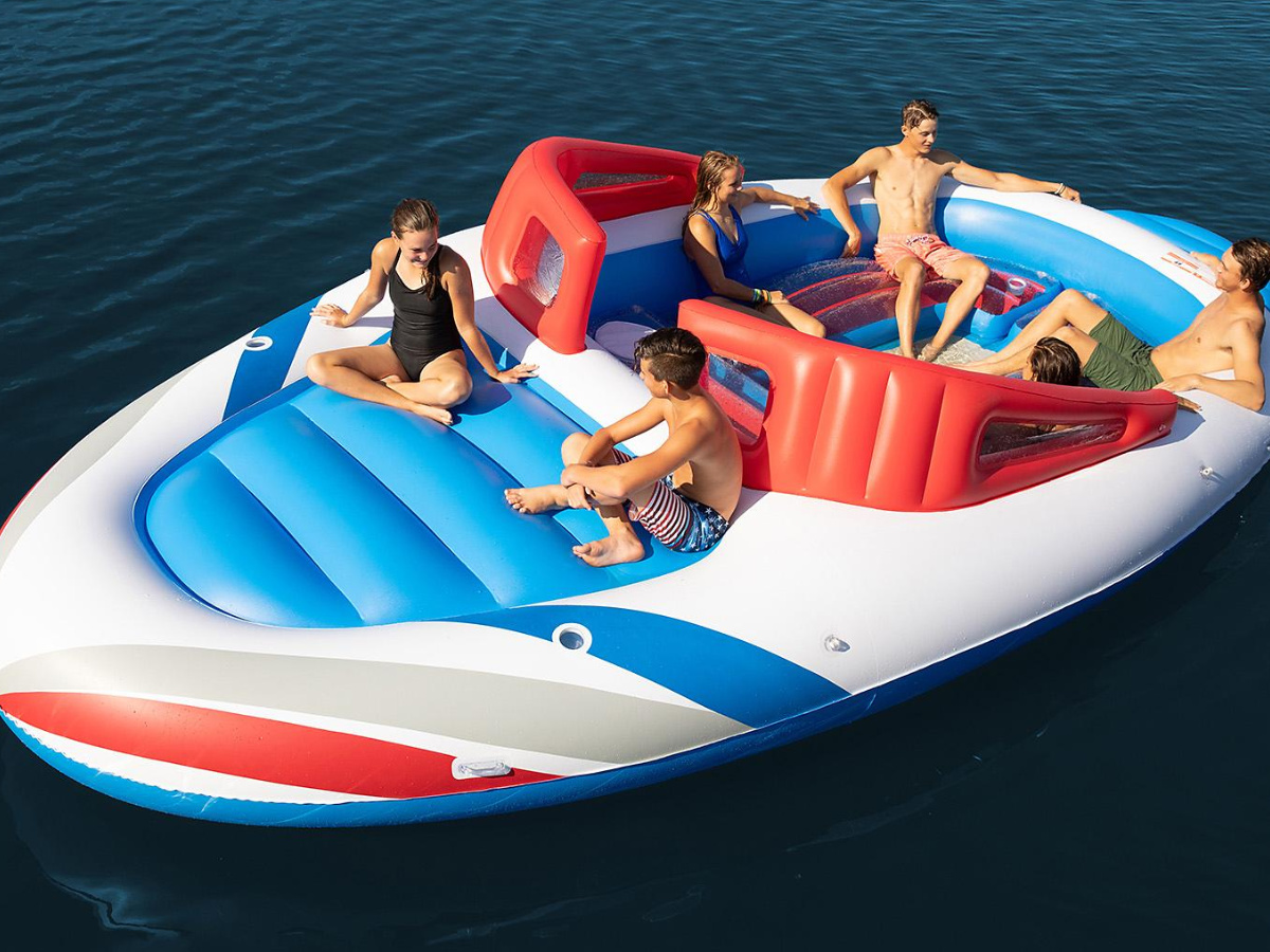people sitting giant boat inflatable