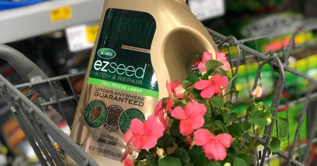 Scott's EZ Seed container in cart with flowers