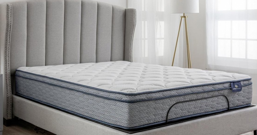 white and navy blue mattress on a grey bed frame with matching headboard in a bedroom