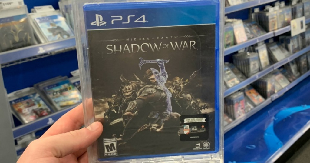 hand holding the Shadow of War PS4 game