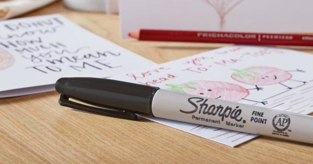 Sharpie laying on papers