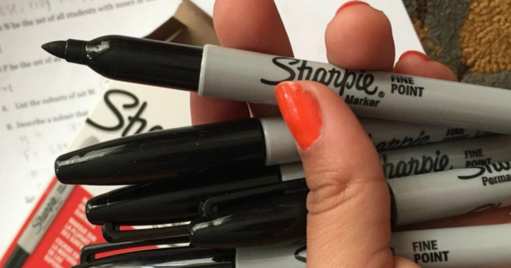 hand holding Sharpie markers