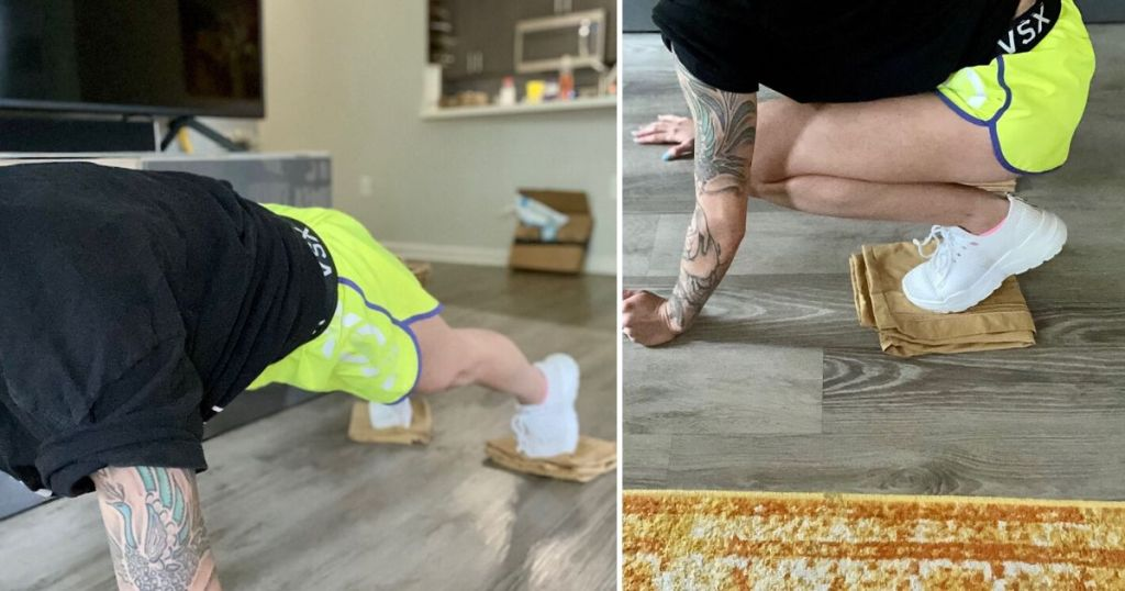Woman demonstrating slider knee tucks with pillow cases under feet