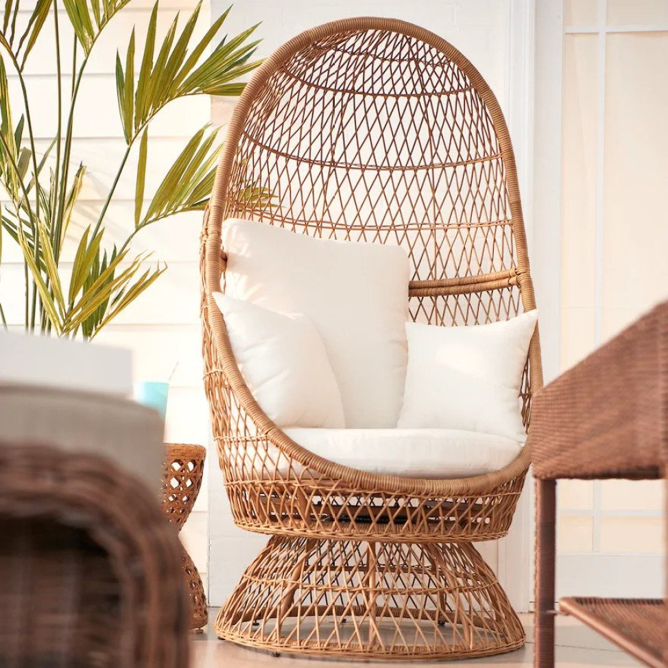 wicker chair that has pillows on it