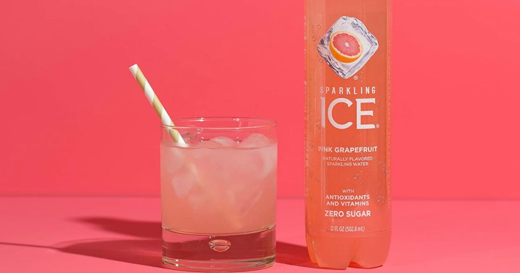 Sparkling Ice pink grapefruit bottle next to pink beverage with a paper straw