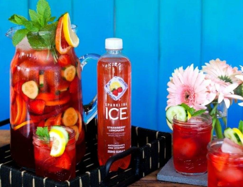 Sparkling Ice strawberry lemonade next to fruit drinks with fruit garnishes