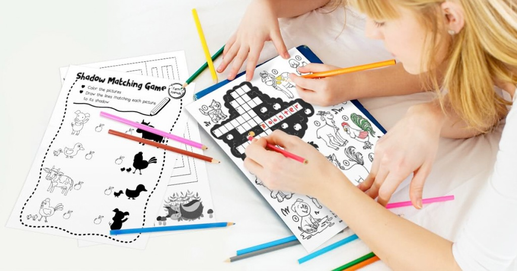 kids using colored pencils to color on coloring pages
