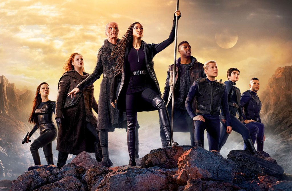 characters of star trek discovery standing on a clif