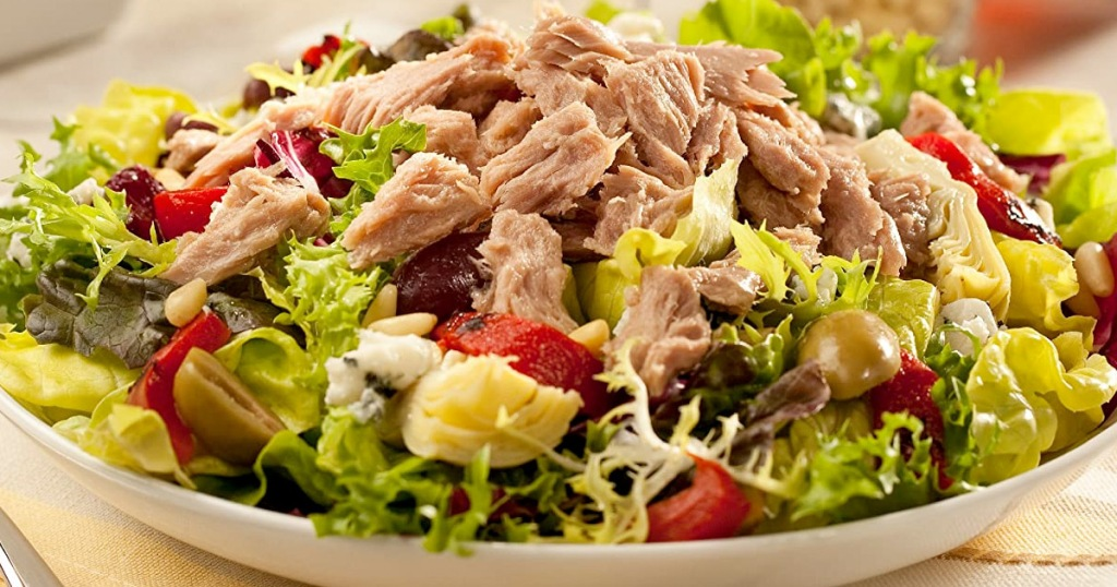 bowl of salad topped with shredded tuna
