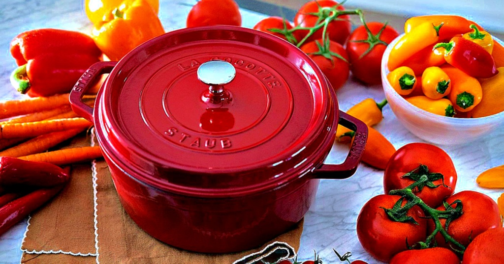 Staub 4-Quart Round Cocotte red on counter with vegetables
