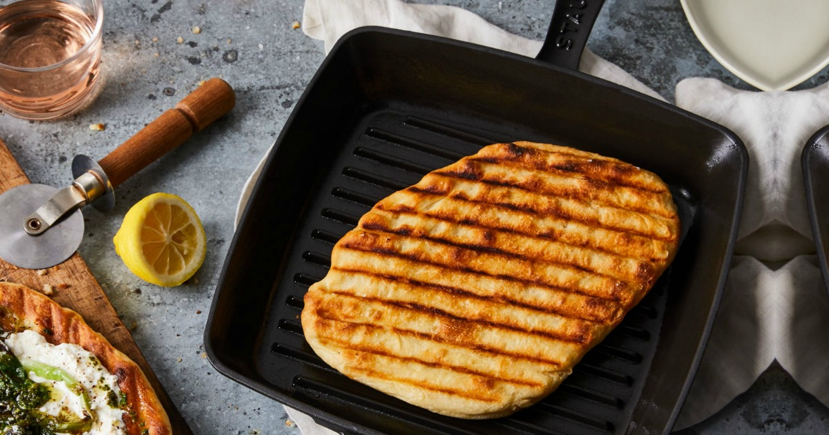 cast iron grill pan with cooked chicken breast resting inside