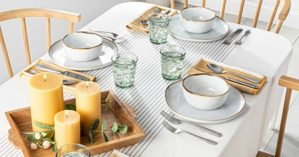 Large farmhouse table set up with striped tablecloth