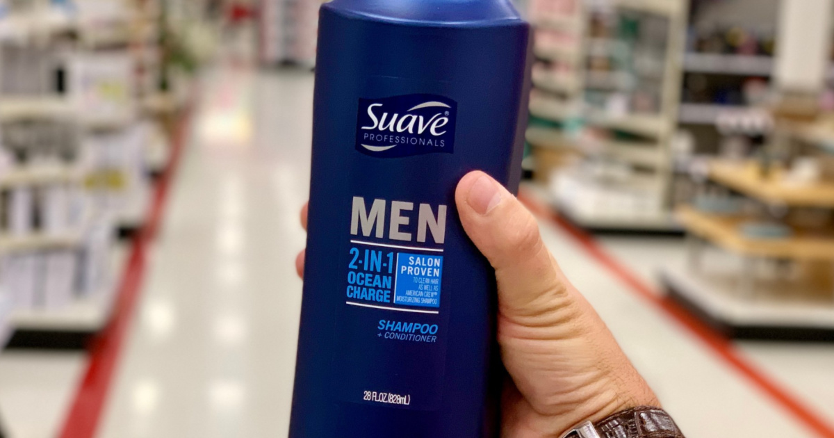hand holding Suave shampoo and conditioner