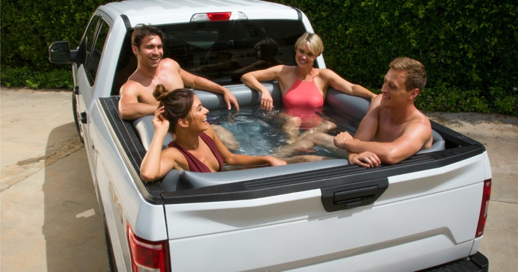 two couples sitting in truck bed pool