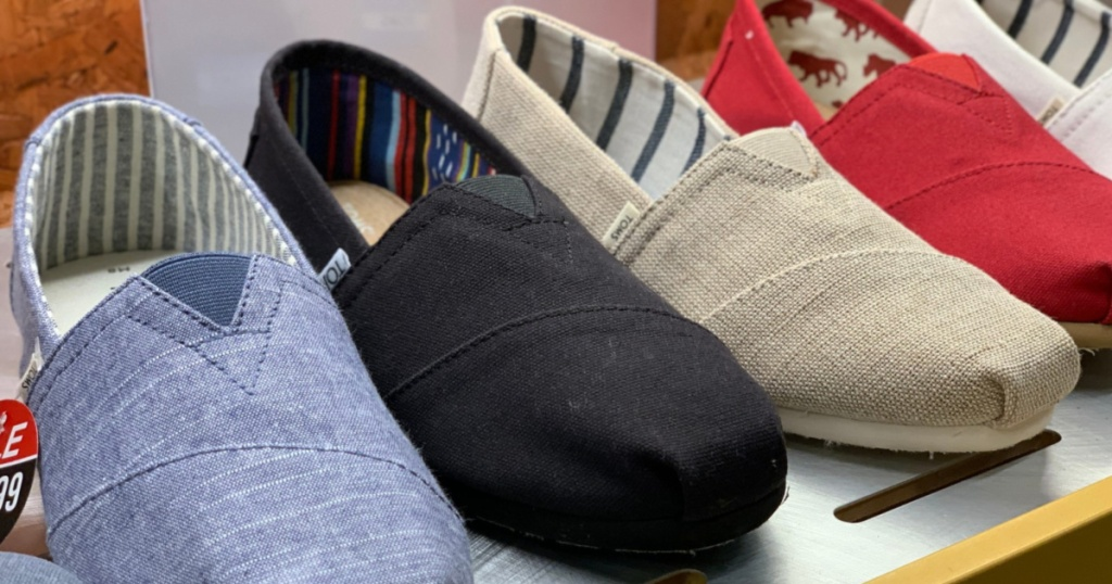 various colors of TOMS slip on shoes on store display