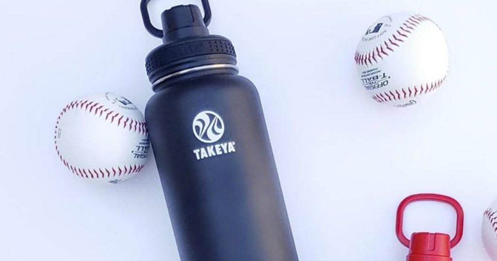 water bottle by baseballs