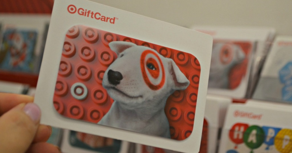 Person holding Target gift card in store