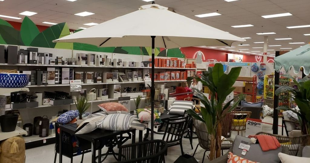 Target store patio department with outdoor table display with patio umbrella