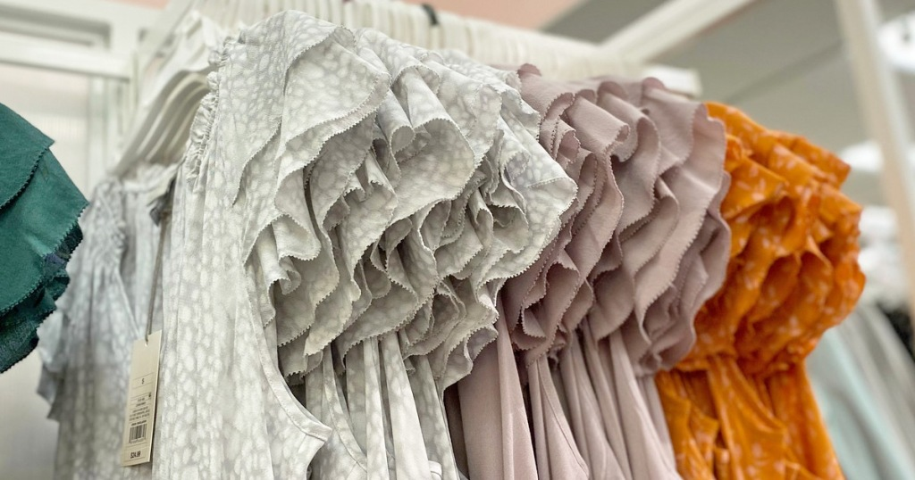 store display rack of womens blouses with flutter sleeves