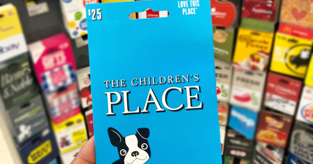 person holding up blue $25 childrens place gift card