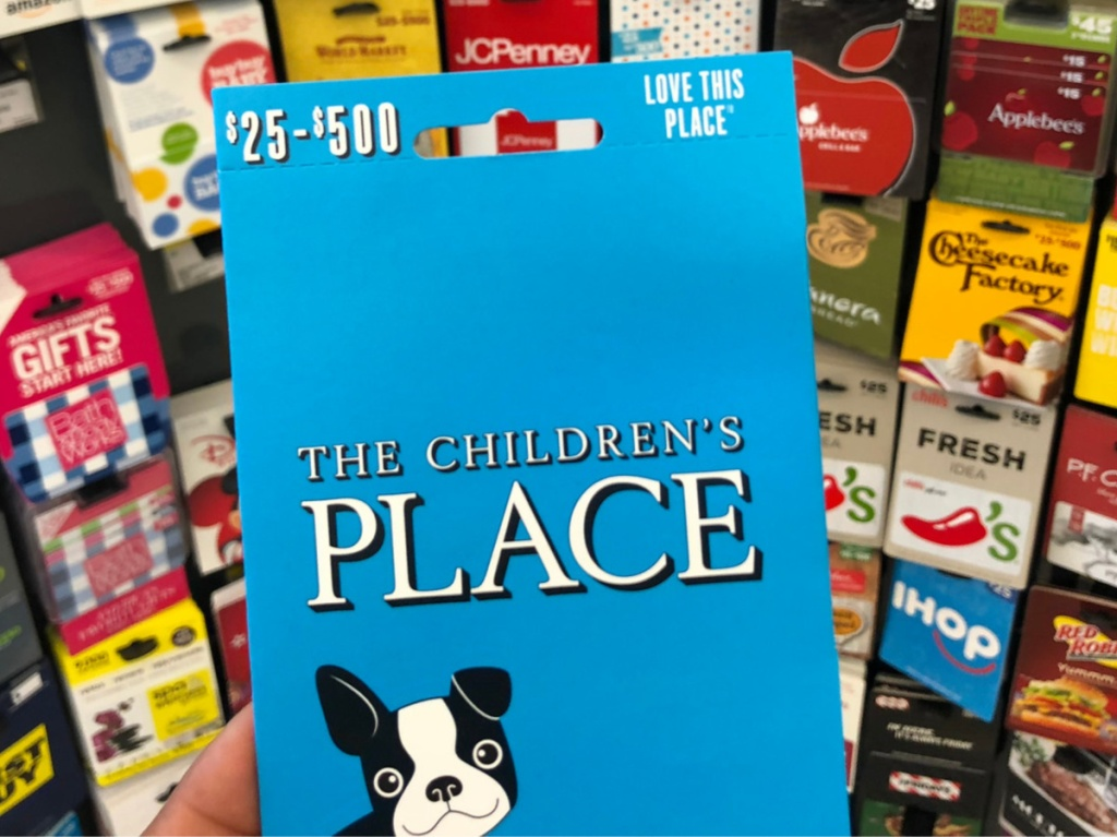 The Children's Place gift card in front of display of gift cards