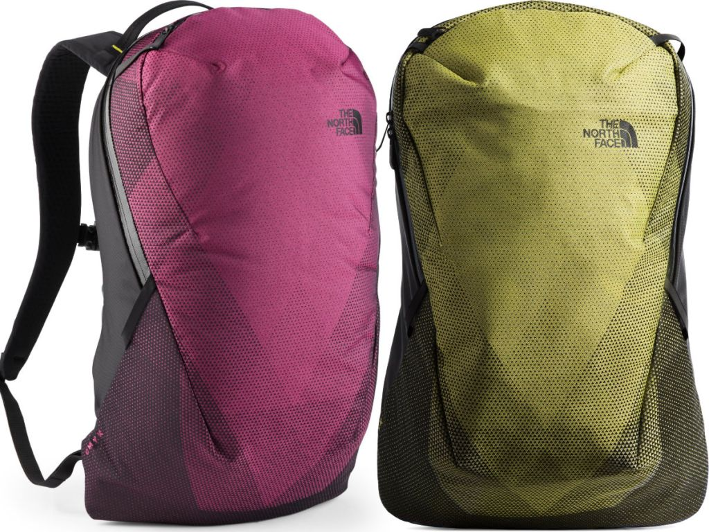 one pink and one mustard yellow The North Face CMYK Pack next to each other