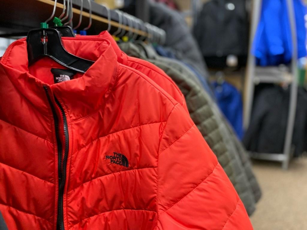 Red North Face Jacket on hanger