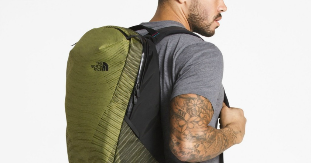 man wearing green backpack