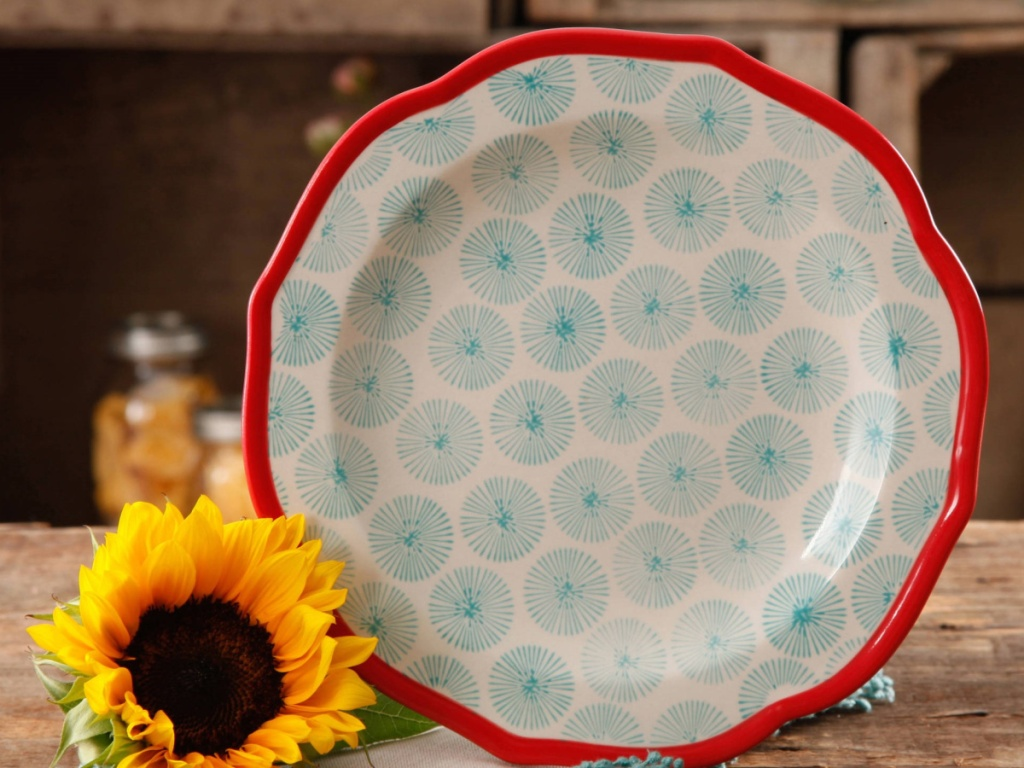 blue and red themed plate with scalloped edges