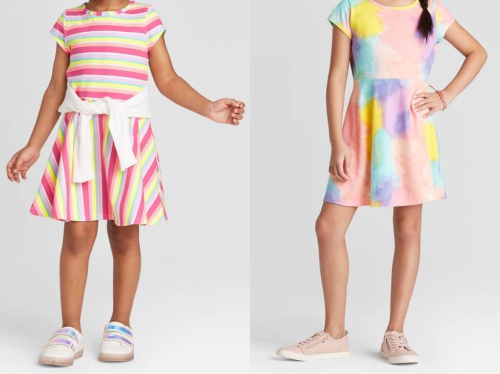 girl in multi-colored striped dress and girl in tie dye dress