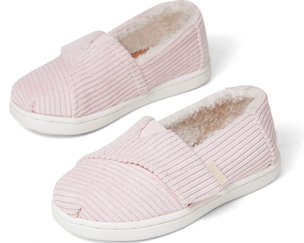 pair of baby size light pink corduroy slip-on shoes
