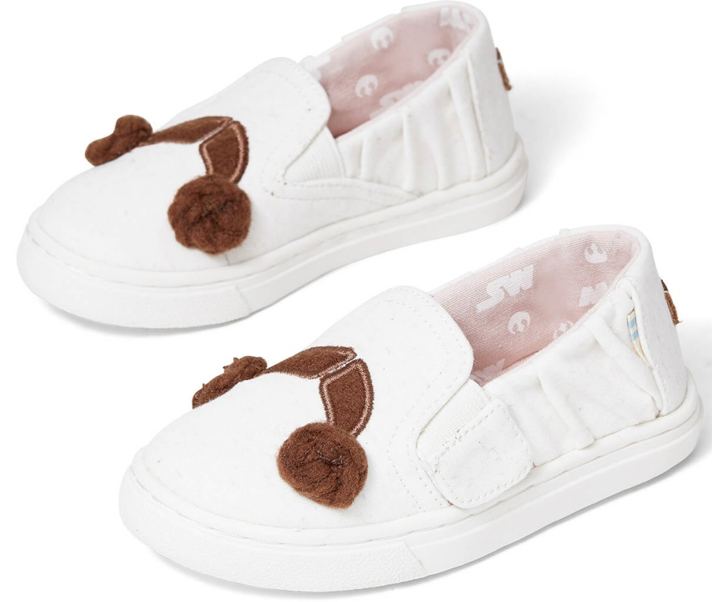 pair of kids white slip-on shoes with princess leia's hair on tops