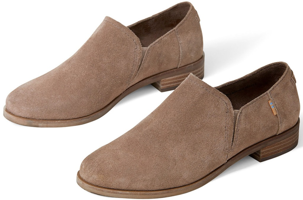 pair of taupe colored suede ankle booties