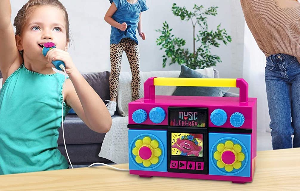 girl holding a microphone by a boombox