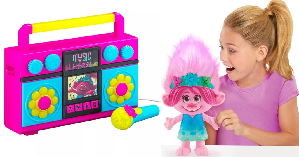 trolls themed kids boombox and girl playing with pink trolls doll
