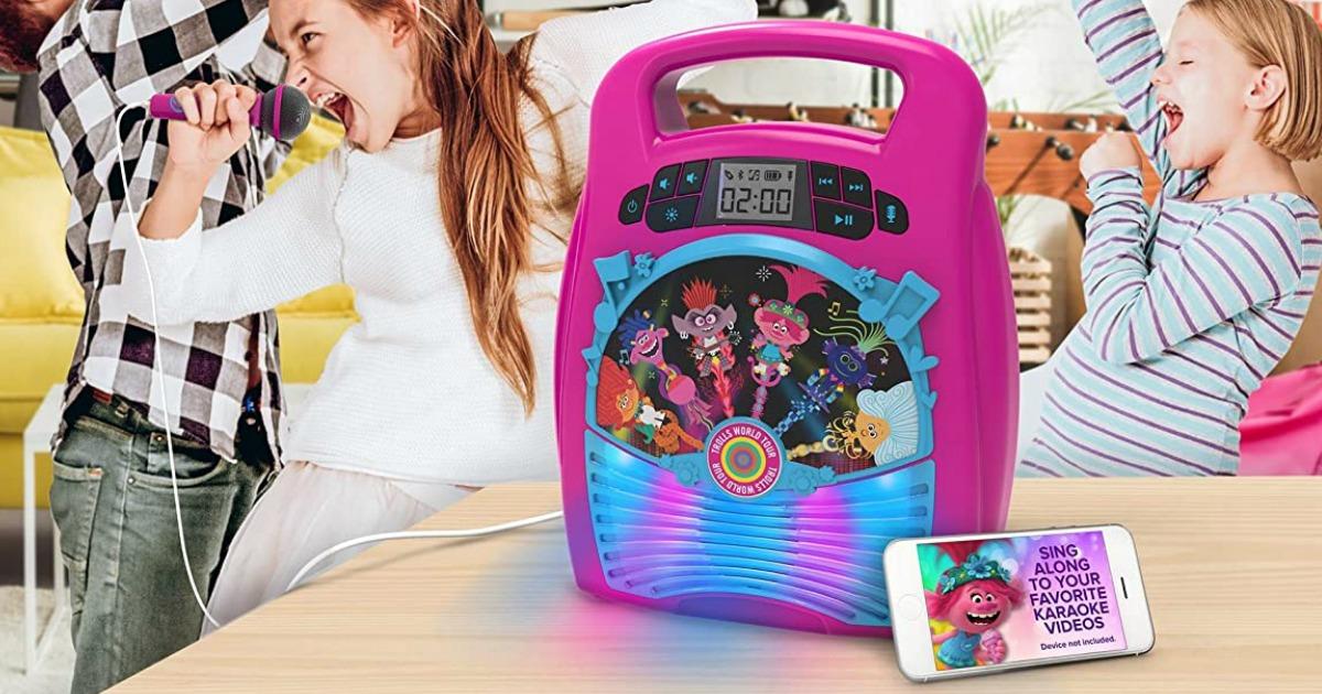 kids singing and dancing by a karaoke machine