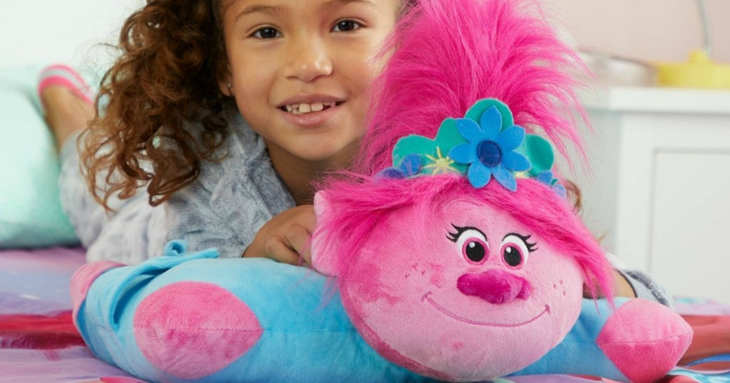 girl laying on a Trolls Poppy Pillow Pet