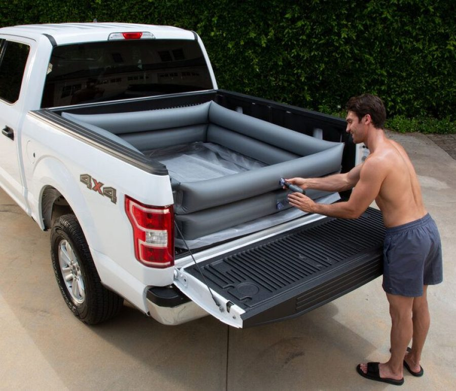 Man inflating truck bed pool