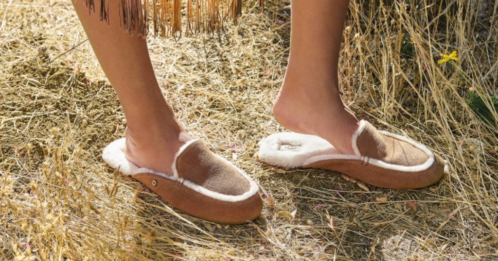 woman wearing a pair of UGG Lane Suede Slipper outside