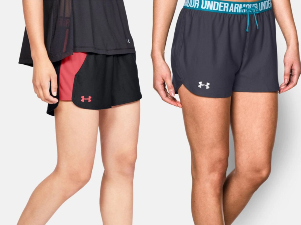 woman in black and pink shorts and woman in gray and blue shorts