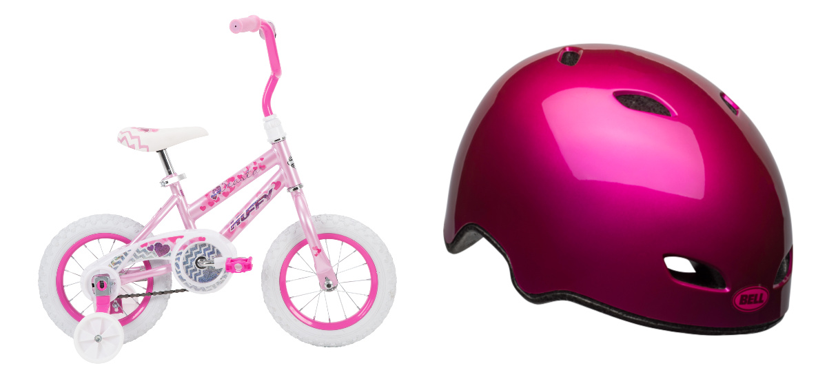 """huffy 12"""" pink bike with pink helmet product display"""