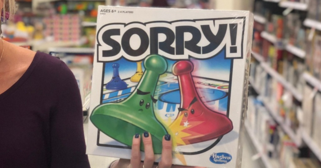 Person holding Sorry! board game