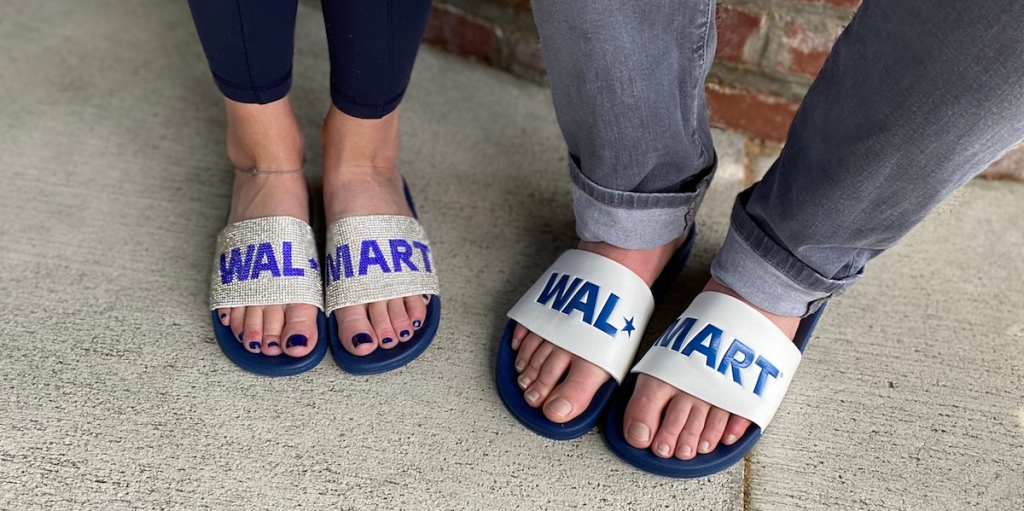two people wearing sandals that say Walmart
