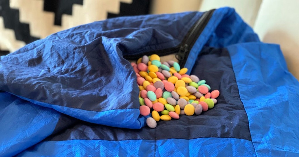 Blue blanket with candy on it