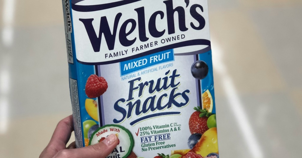 hand holding box of fruit snacks